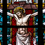 Stained glass window design of Jesus on the cross